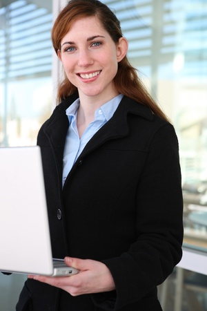 A pretty young business woman with a laptop computer photo