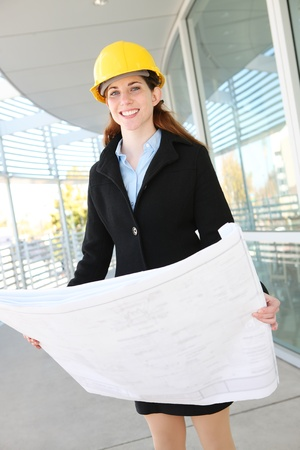 executive helmet: Woman Architect at work site with blueprints Stock Photo