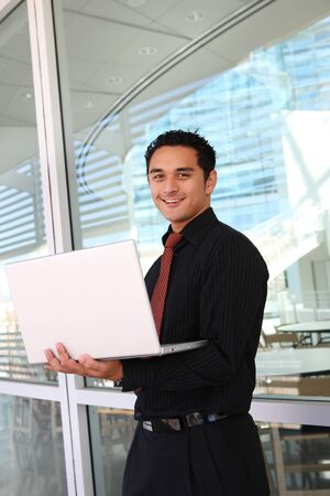 mature mexican: Handome hispanic business man at office with laptop computer