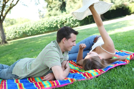 Attractive man and woman couplehaving fun in the park photo