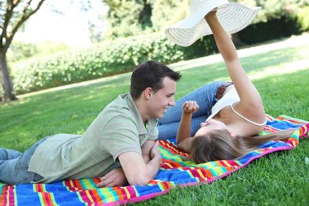 Attractive man and woman couplehaving fun in the park Archivio Fotografico