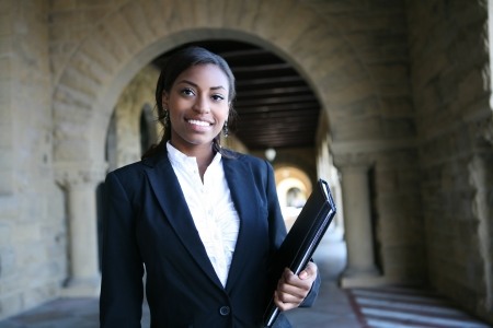 A young and pretty african american woman at college photo