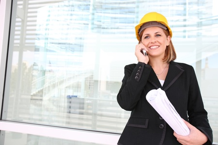 A woman construction manager on a building site talking on phone. Stock Photo - 10830168