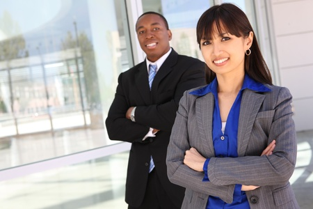 A pretty asian woman with handsome african american business man coworker in background photo