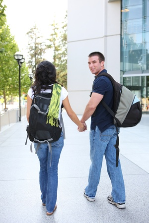 A young man and woman couple in love at the school library photo