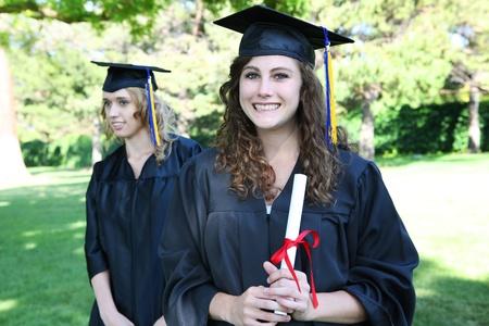 Pretty young woman at graduation holding diploma Stock Photo - 10907647