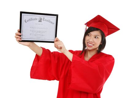 A pretty asian woman at graduation holding her degree Stok Fotoğraf