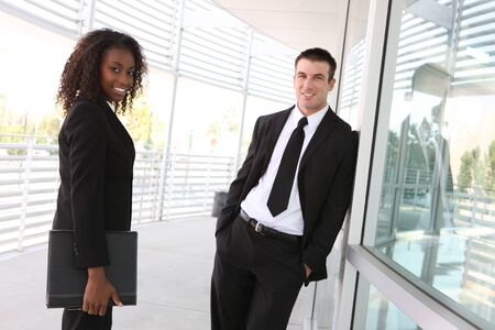 An ethnic diverse man and woman business team at office building photo