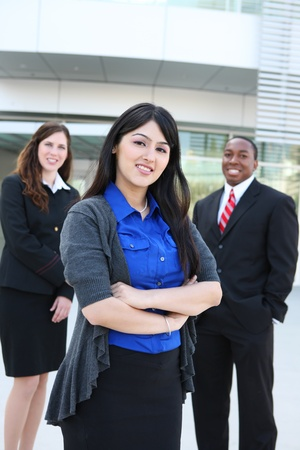 Attractive business man and women team at office building photo