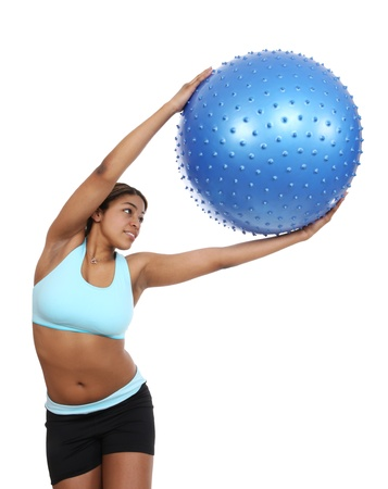 A pretty african american woman exercising over white background photo