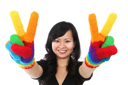 A happy asian woman with rainbow gloves giving peace sign photo