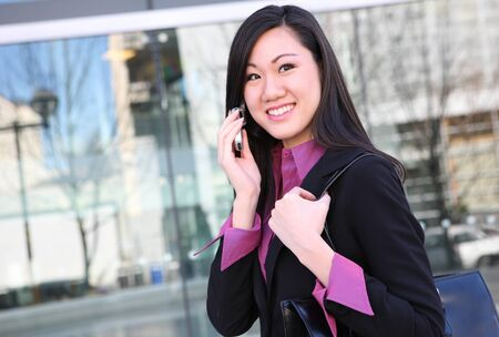A young, pretty asian woman business woman at the office Stock Photo - 10960762