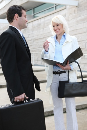 An attractive man and woman business team at the office building Stock Photo - 10960757