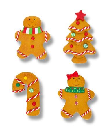 Vier Gingerbread Cookie kerst ornamenten geà ¯ soleerd over white