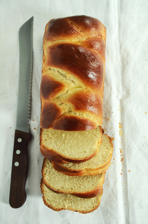 challah: Braided challah bread shaped rectangular and cut in pieces