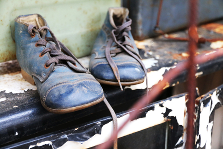 shoelaces: Old and dirty blue shoes with shoelaces