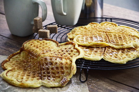 freshly: Freshly baked waffles on a cooling rack