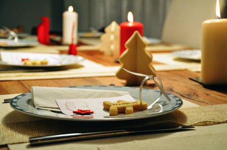 Festive decorated dinner table for Christmas or New Year celebration
