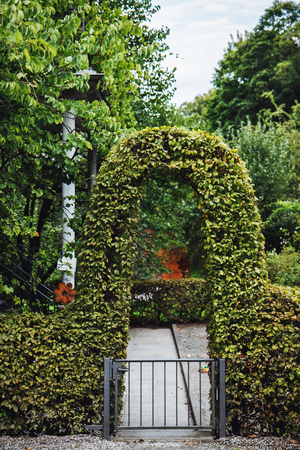 Attirant Garden Gateway Arc Perfectly Bent And Groomed. Summer Time Or Springtime.  Stock Photo