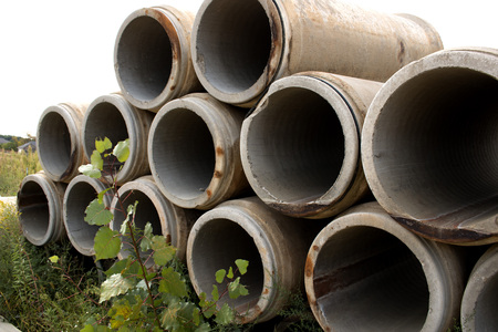 Sewer pipes stacked outside Stock Photo