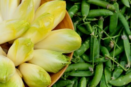 endive: Heap of belgian endive and peas