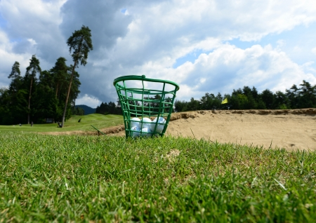 golf swing: Golf balls in the basket on the grass