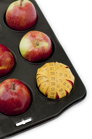 Apples in muffin tray Stock Photo