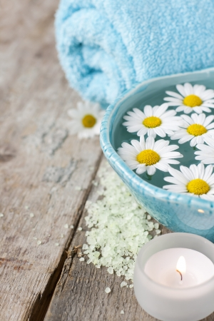 Spa setting with daisies photo