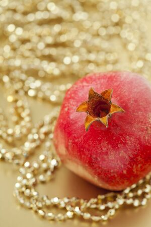 Pomegranate with bead garland
