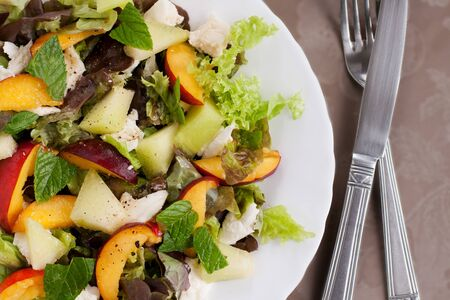 Fresh salad with melon, nectarines and mozzarella