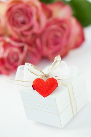 Valentine gift box decorated with heart, roses on background Stock Photo - 17236128