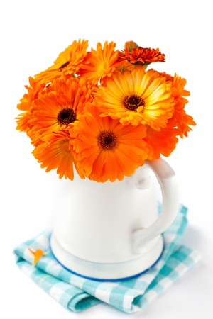 Bouquet of orange flowers on white Stock Photo - 17444988