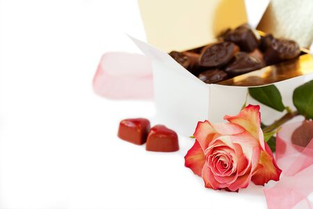 Romantic setup with chocolates and rose