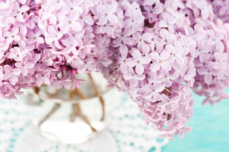Bunch of beautiful lilac in vase photo