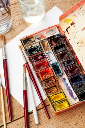 Watercolor paint box and brushes for painting   photo
