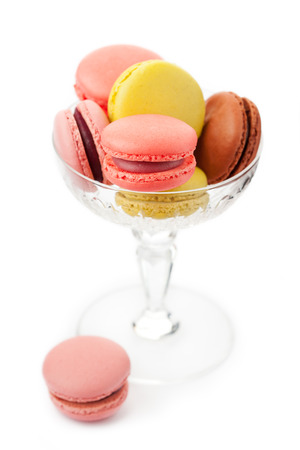 Colorful macaroons in glass vase
