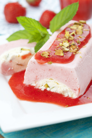 Home made strawberry ice cream with sauce