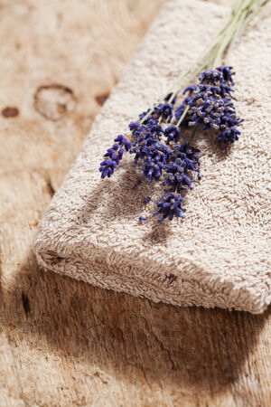 Bouquet of lavender flowers on towel, spa concept photo