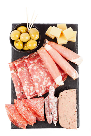 Charcuterie assortment and olives on white background Stock Photo