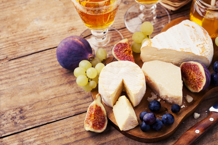 Variety of cheese sorts with grapes and figs Stock Photo