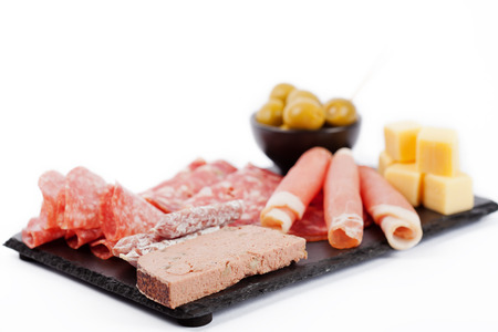Charcuterie assortment and olives on white background 免版税图像