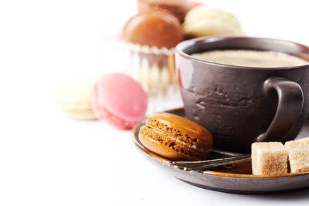 hot coffee: Cup of coffee and macaroons on white background, toned Stock Photo
