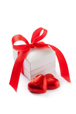 Valentines day concept: gift box and heart shaped chocolates on white Stock Photo