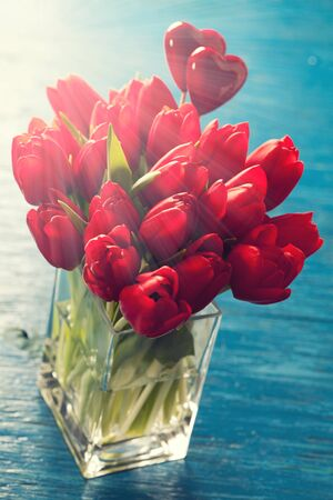 Valentine day concept:  bunch of red tulips in vase