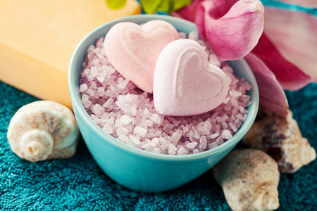 towels bath: Spa setting with bath salt  and bath accessories on blue towel Stock Photo
