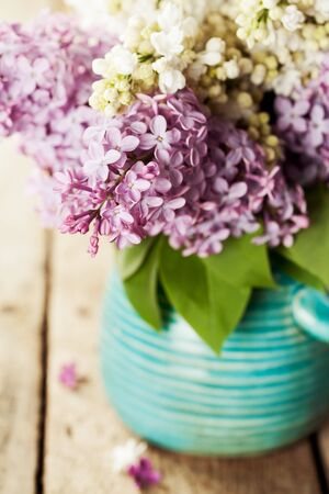 brunches: Brunches of white and purple lilac in vase