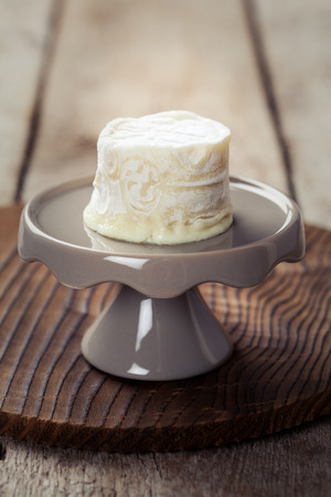 Goat cheese on a stand Stock Photo