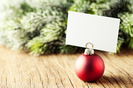 Red christmas ball with white card attached
