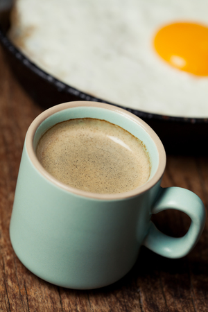 Breakfast setting with coffee and fried egg