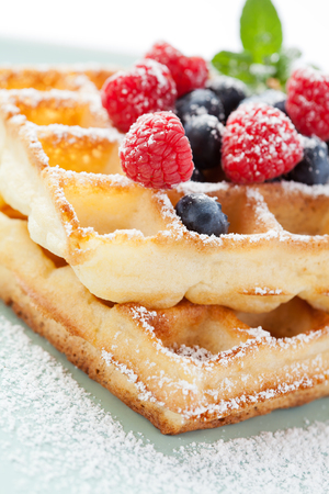 close up food: Fresh homemade brussels waffle with berries